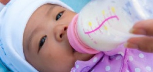 Infant Drinking Formula From Bottle
