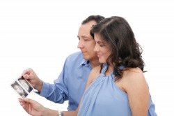 Couple Looking At Ultrasound Photos