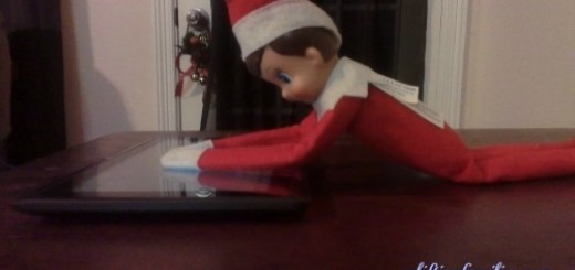 Rascal Elf on the Shelf Playing on The Tabelt