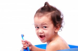 Baby And Toothbrush