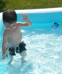 Child Playing in Wading Pool