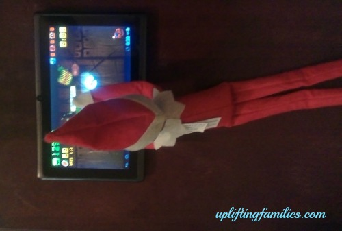 Rascal Elf on the Shelf Playing Fruit Ninja