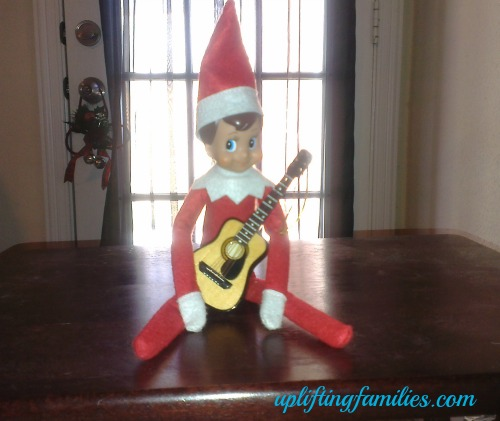 Rascal Elf on the Shelf Playing Guitar
