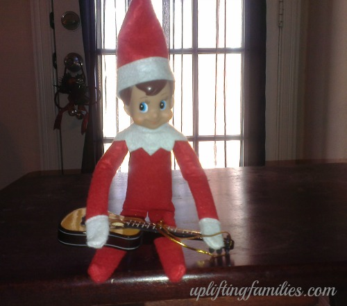 Rascal elf on the Shelf Playing Tap Harmonics on the Guitar