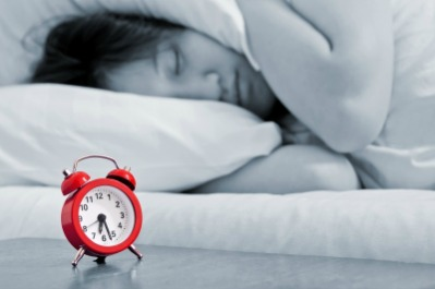 Teenager Ignoring Alarm Clock Due to Sleep Deprivation