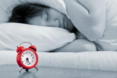Teenager Ignoring Alarm Clock Due to Sleep Deprivation