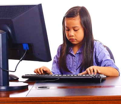 Child Learning How to Use the Computer
