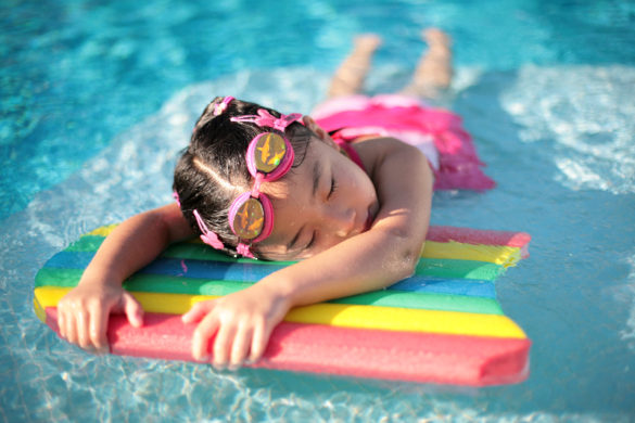 Optimized-Girl_with_styrofoam_swimming_board